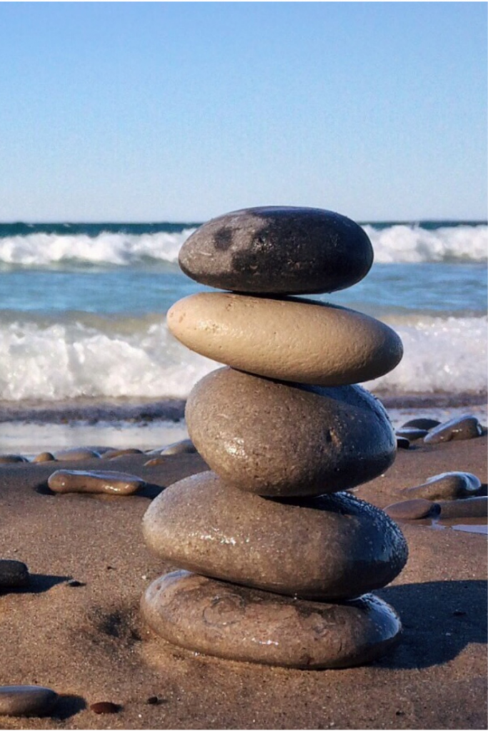 Life-changing priority rocks stacked on each other at the beach