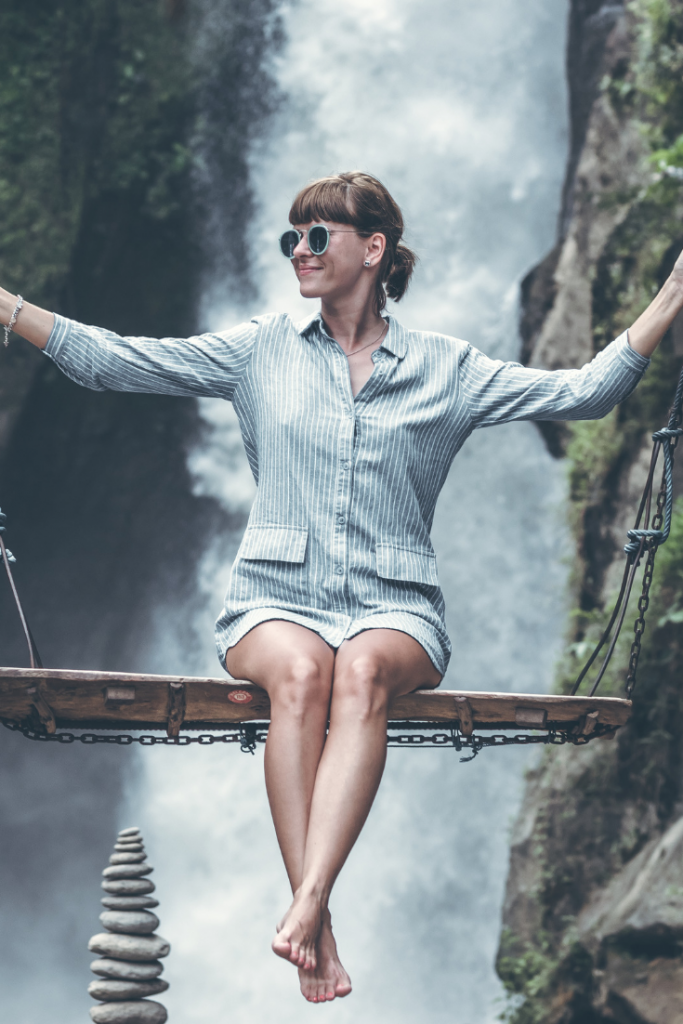 Woman at a water fall trusting that the swing will hold her if she falls. Will Jesus catch you if you fall?