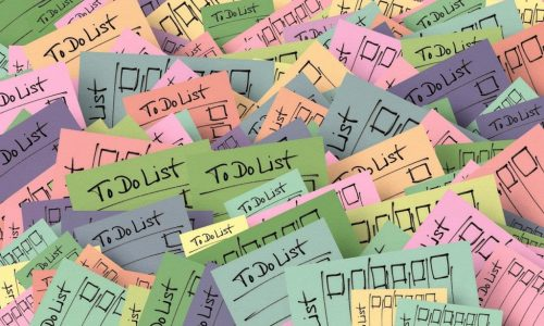 Post itw notes scattered with to-do lists on them